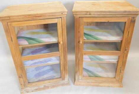 A pair of reclaimed pine glazed cabinets