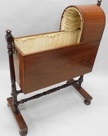 A 19thC mahogany child's cot