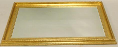 A gilt rectangular wall mirror