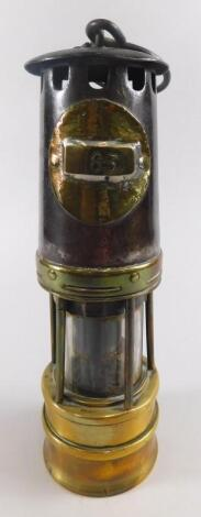 A late 19th/early 20thC brass and iron miner's lamp