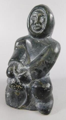 An Inuit carved stone figure of an Eskimo