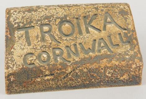 A Troika brick shaped stoneware shop window display