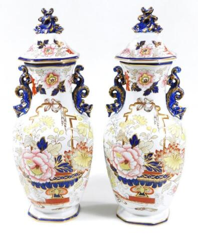 A pair of 19thC Masons octagonal vases and covers