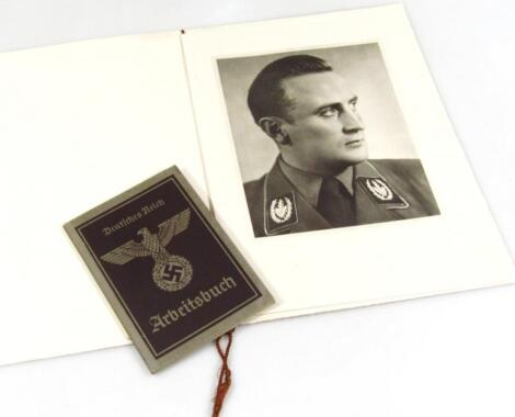 A Third Reich Arbeitsbuch in the name of Wilsech numbered 26FRI/000494