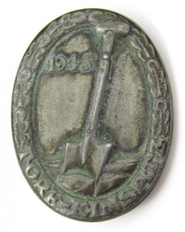 A Third Reich Hitler Youth 'Torf-Einsatz' badge dated 1943