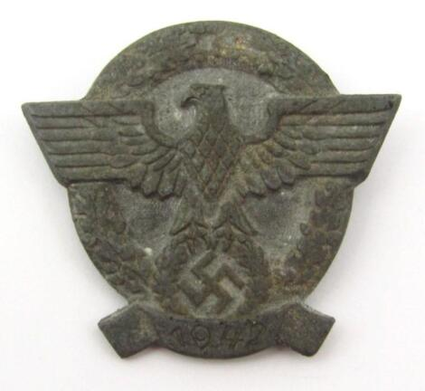 A Third Reich Hitler Youth badge dated 1942