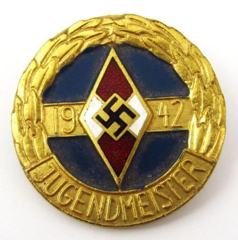 A Third Reich Hitler Jugend 1942 Jugendmeister 'gold' coloured badge