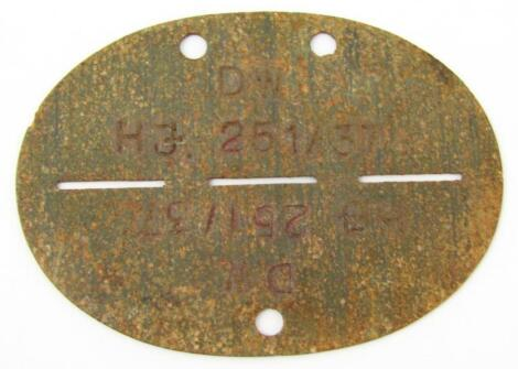 A Third Reich Hitler Jugend 'dog tag' identification tag