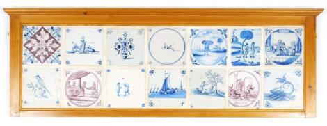 A panel of fourteen English and Dutch Delft tiles