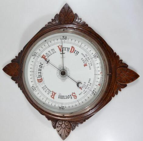 An early 20thC oak wall barometer