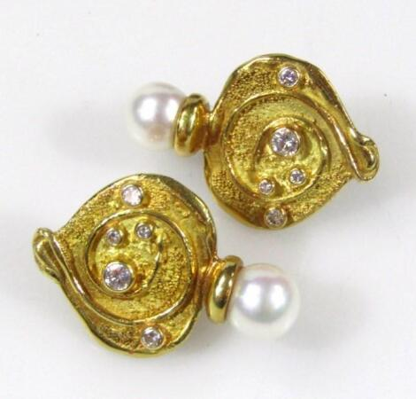 A pair of 18ct gold diamond and pearl earrings