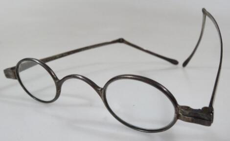 A pair of early 20thC silver framed spectacles