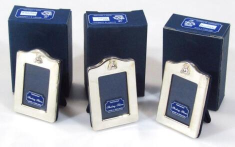 Three sterling silver photograph frames