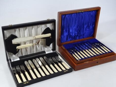 An Edwardian silver entrée knife and fork set