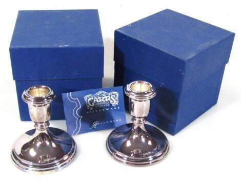 A pair of Elizabeth II silver dwarf candlesticks
