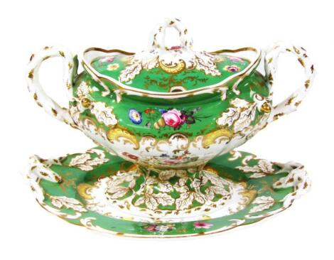 A Rockingham tureen cover and stand