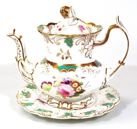 A Rockingham teapot cover and stand
