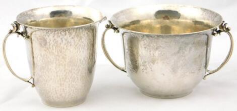 A Georg Jensen sterling twin handled sugar bowl and cream jug
