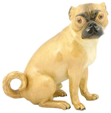 A Meissen porcelain model of a seated pug