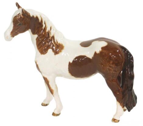 A Beswick Skewbald pony