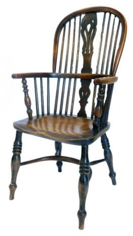 A mid 19thC yew ash and elm Windsor chair