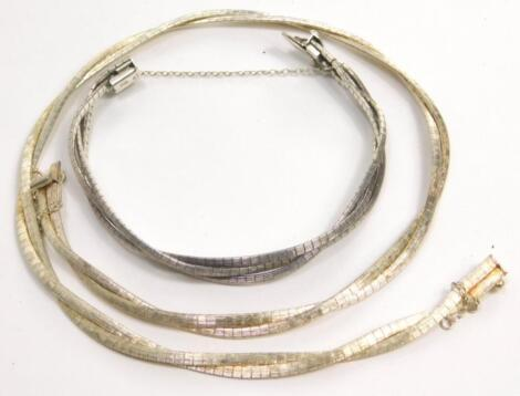 Two abstract silver jewellery items