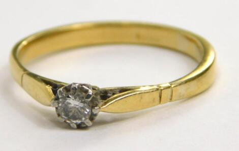 An illusion set diamond solitaire ring