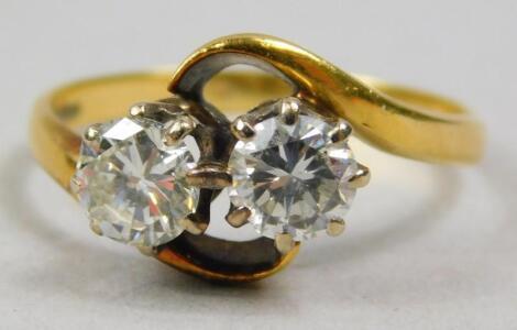 An 18ct gold two stone diamond dress ring