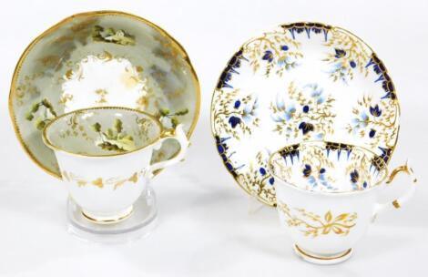 A puce Griffin marked cup and saucer