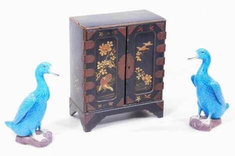 A pair of Chinese pottery figures of standing ducks