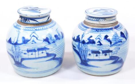 A pair of 18thC blue and white pottery jars and covers