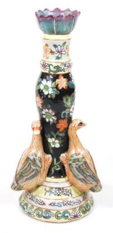 A 20thC Chinese pottery Ming style candlestick