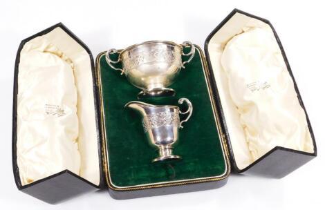A George V silver cream jug and sugar bowl set