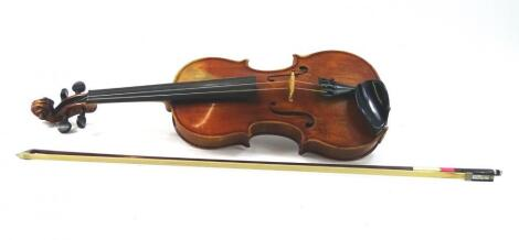 A stained walnut cased violin