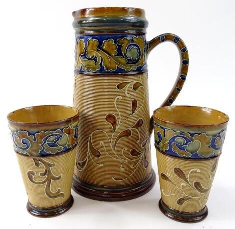 An early 20thC Doulton Lambeth stoneware part drinks set