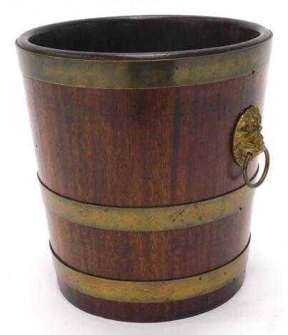 A 19thC mahogany and brass coopered waste paper basket or jardiniere