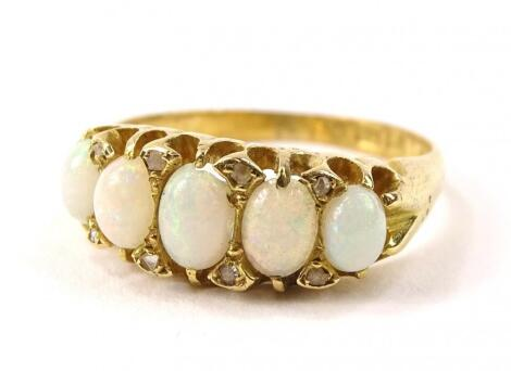 An 18ct gold five stone opal dress ring