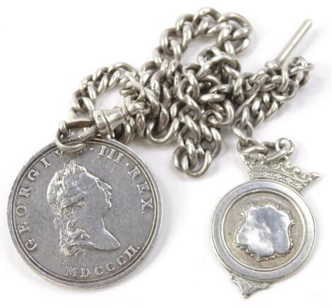 A silver watch chain and fob