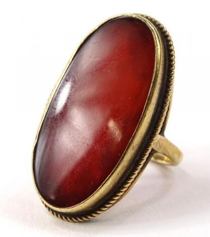 A 9ct gold orange agate stone set dress ring