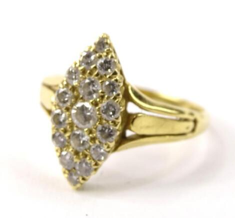 A diamond set pave shaped dress ring
