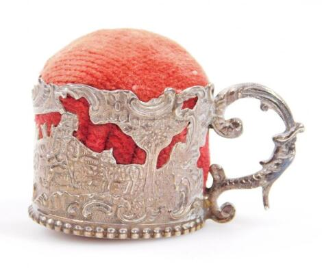 A Victorian tankard pin cushion