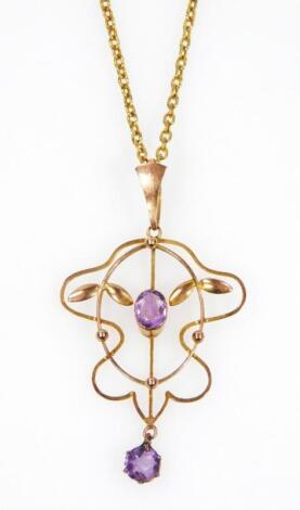 An early 20thC Art Nouveau yellow metal drop pendant