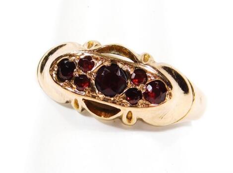 A ladies 9ct gold garnet dress ring