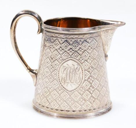 A Victorian silver and silver gilt cream jug