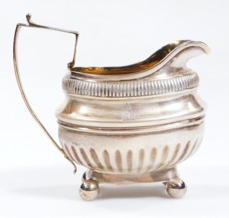 A George III silver and silver gilt cream jug
