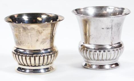 A matched pair of silver campana shaped vases