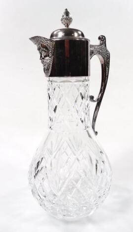 An Elizabeth II silver and cut glass claret jug