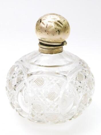An Edwardian silver and cut glass dressing table perfume bottle