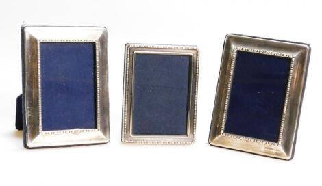 Three similar Elizabeth II silver fronted photograph frames