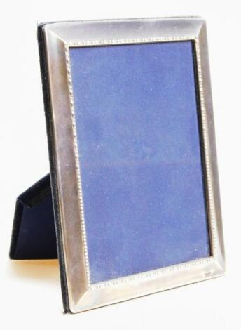 An Elizabeth II silver fronted photograph frame
